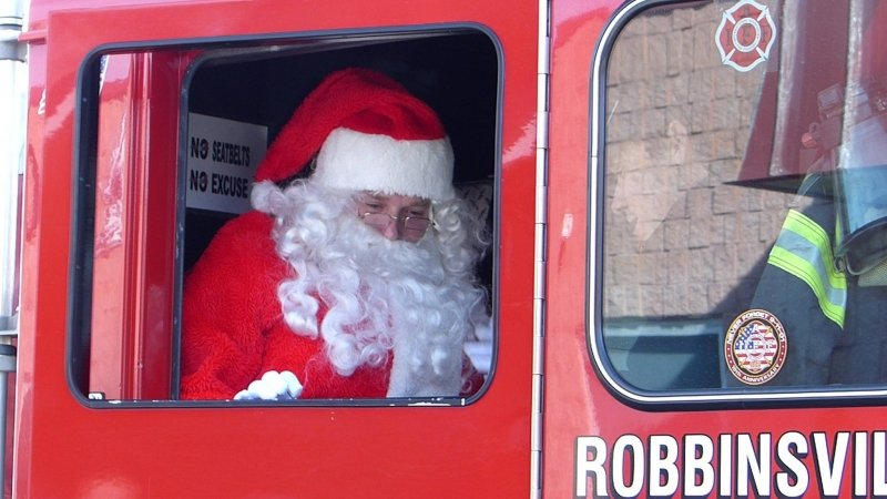 Santa Arrives at Holiday Bazaar By Fire Engine